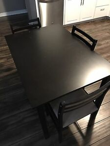 Brown kitchen table. Three chairs
