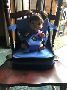 Portable high chair- the first years