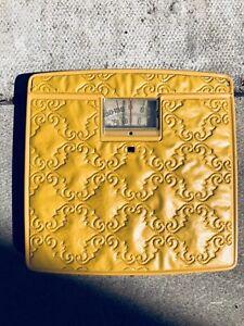 Vintage yellow bathroom scale