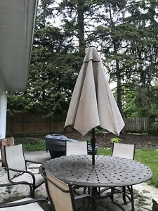 Great patio set with 6 chairs and umbrella