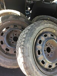 "Four 15"" studded winter tires and rims $300"