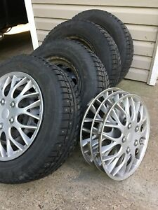 4x 195/65R15. Studded winter tires on rims