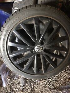 """Vw 17"""" rims and tire set"""
