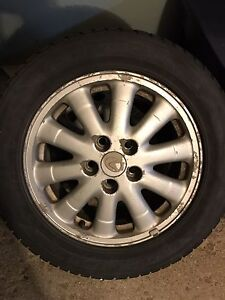 Set of Dunlop snow tires and rims