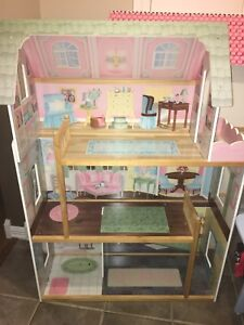 Two large Barbie houses