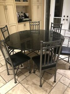 Round kitchen/dining table with chairs