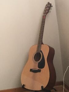 Acoustic guitar, with stand, tuner, capos etc
