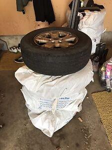 """4 Ford 16"""" Aluminum Rims w/Tires"""