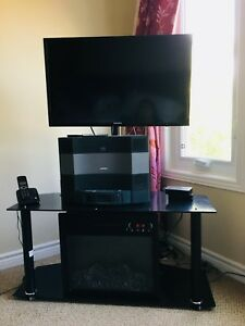 Samsung TV with fireplace stand