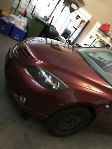 Red 2006 Mazda 3 Hatchback GT Manual. Price is OBO