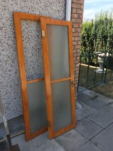 Two piece solid wood with privacy glass insert parlor doors