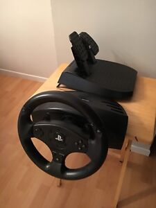 Thrustmaster T80 racing wheel and pedals, like new in box.