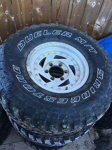 "33"" mud tires on rims"