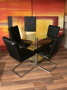 4 Contemporary black leatherette chairs