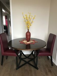 "46"" diameter round table and 2 leather chairs"