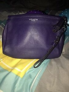 ** PURPLE LEATHER COACH WRISTLET **