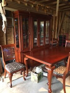Six seat dining table with matching China hutch.