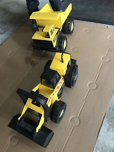 Big metal tonka trucks perfect condition