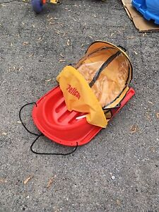 Sled with cover