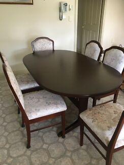 Butterfly extension dining table. With 6 chairs