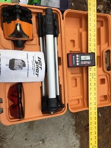 Laser level with detector and ruler