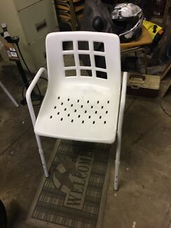 Shower chair with adjustable legs