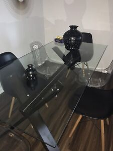 Moving Sale - Glass dining table & 6 chrome/wood base chairs