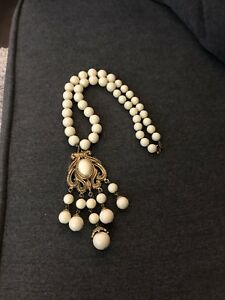 """Cream coloured necklace with gold medallion  - 14"""" long"""