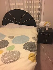 Queen size bed with two matching night tables