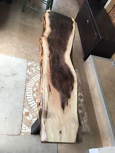 Unique wood slab and rustic barn board tables benches cabinets