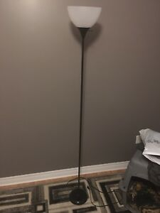 Black floor lamp with white plastic shade