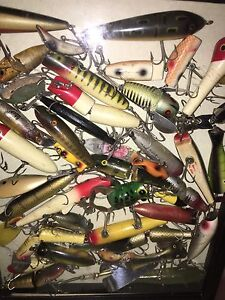 Old Fishing Lures or Toy Cars and Trucks