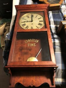 Antique wall clock Canadian time