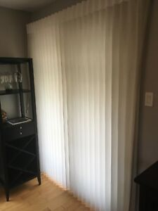 Hunter Douglas sheer vertical blinds.