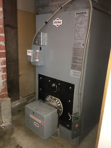 Warm air furnace with oil tank