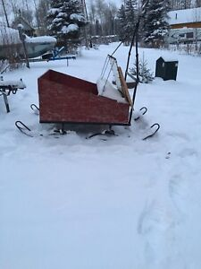 Pull behind snowmobile cutter