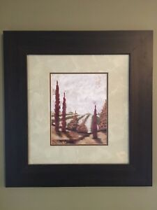 Artwork in dark wood frame