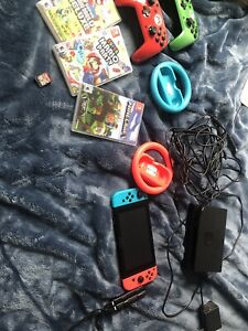 Nintendo Switch With 4 Games, and extra controllers