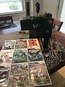 Wii Console (1st generation) with 10 games.