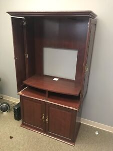 Cabinet with hidden locking compartment