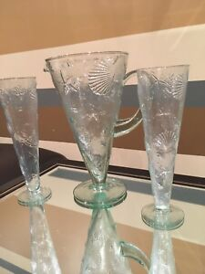 Brand new glass pitcher and glasses set