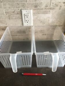 Six identical clear organizing baskets with handles