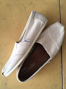 Cream coloured TOMS (size 10)