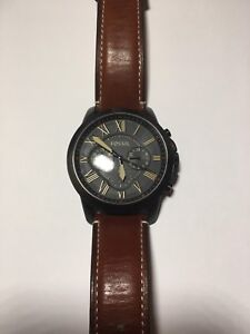 Black and Gold Fossil Chronograph Watch
