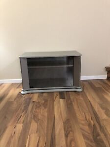 $40.00  T.V. STAND , GRAY