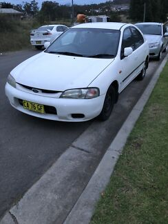 ford laser ghia 1996 | New and Used Cars, Vans & Utes for Sale ... on ford laser box type, ford laser cars, ford laser kh, ford laser 2000, ford laser mod, ford laser glxi, ford laser kf, ford laser 1989, ford laser lxi, ford laser 0-100 km, ford laser hatchback, ford coupe laser, ford laser 1985, ford laser parts, ford laser gl, ford laser sport, ford laser 1982, ford laser 1981, ford laser 2014,