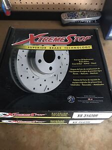Cross drilled and slotted rear rotors with pads