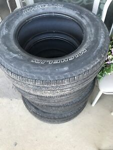 235/70/16 SET OF 4 USED MICHLEIN TIRES ALL SEASON