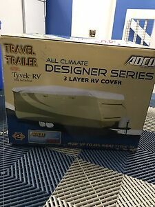 Brand New in box never used 26-28ft ADCO travel trailer cover