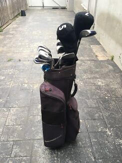 Golf clubs and buggy for sale
